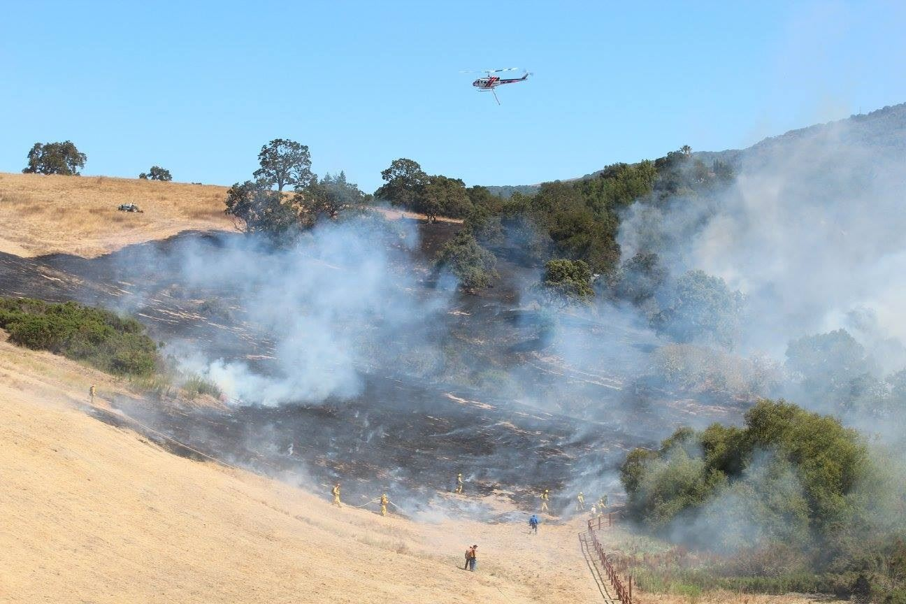 Firefighters and Helicopters Working to Extinguish Byrne Preserve Fire