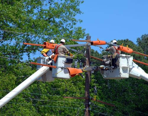 this is an image of men working on the power grid outdoors